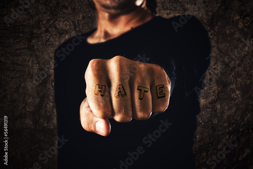 Hand with clenched fist - tattooed hate