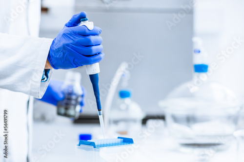 Hands of a researcher carrying out scientific research experimen