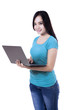 Beautiful young woman with laptop computer