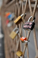 Love padlocks tied to a fence