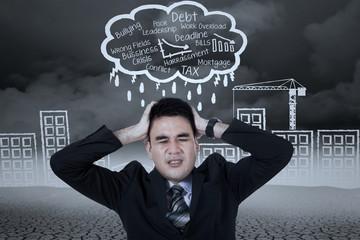 Stressed businessman with a headache