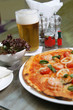 Seafood Pizza with salad and beer