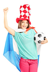 Happy female fan with hat and dutch flag holding a football