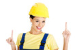 Female construction worker pointing on copy space