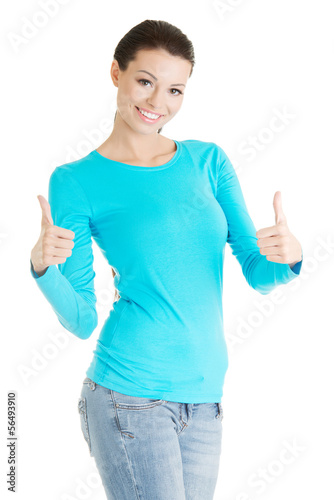 Beautiful young woman gesturing thumbs up.