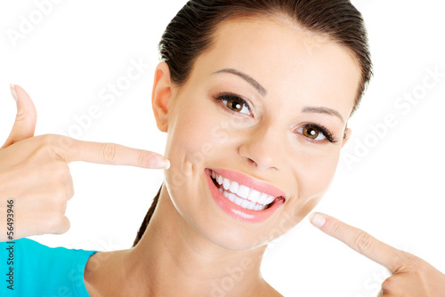 Woman showing her perfect  teeth.