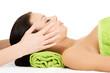 Beautiful relaxed woman enjoy receiving face massage