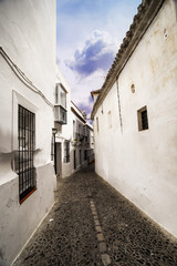 Narrow white street in Arcos de la Frontera, Cadiz (Andalusia).