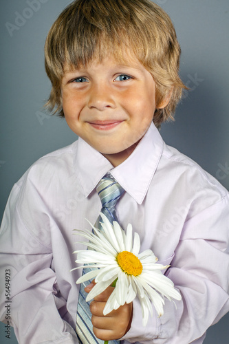 handsome boy with flowers in hands