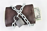 Wallet full of money is chained with a padlock