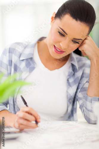 young woman filling her tax forms