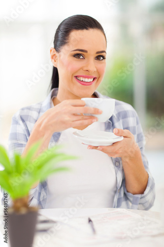 young adult woman drinking coffee