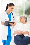 medical doctor consulting senior patient in office