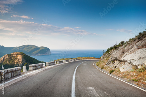Right turn of mountain highway with blue sky