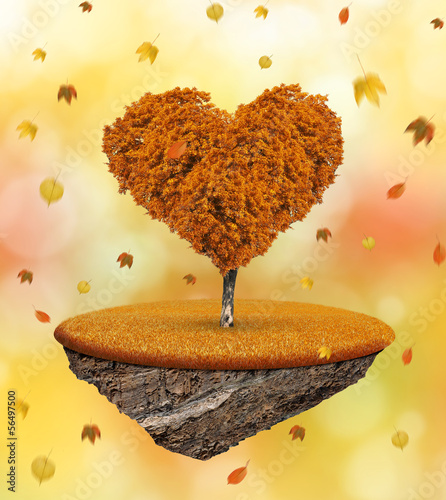 Little island and autumnal tree in the shape heart
