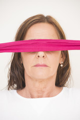 Portrait mature woman blindfolded