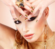 Beautiful fashion woman with black makeup and golden manicure