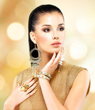 Fototapety Beautiful fashion woman with black makeup and golden manicure