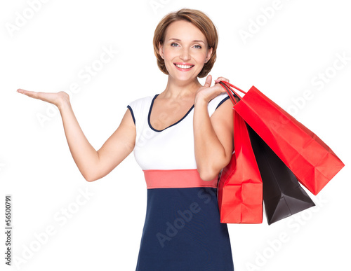 happy woman with presentation gesture and shopping bags