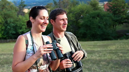 With binoculars in nature