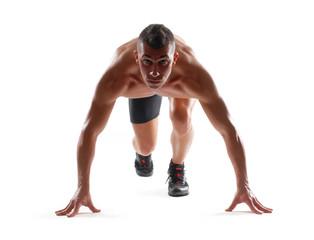Corredor atleta en posición de partida.