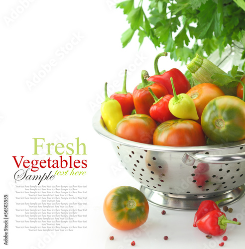 Vegetables in colander, isolated on white