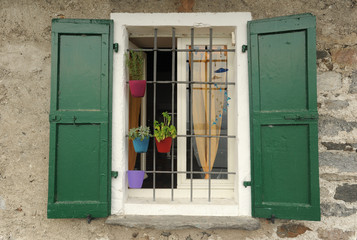 Window with pot of herbs at Fisherman's island on lake maggiore