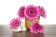 Pink Gerbera in yellow basket and white stones