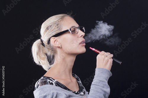 Young woman smoking e-cigarette