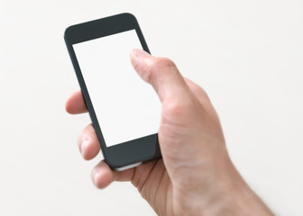 Holding and touching on mobile phone with blank screen