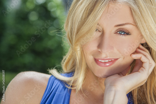 Beautiful Blond Woman With Blue Eyes