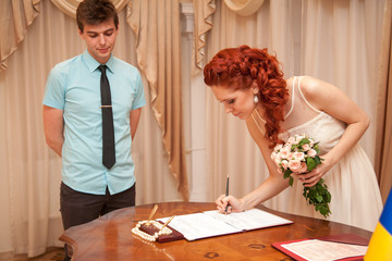 Young bride signing wedding contract