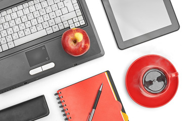 Laptop and office supplies on white