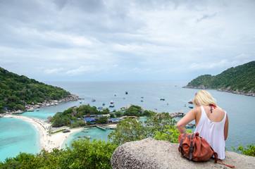 A girl sit on the cliff at Nang Yuan island. Thailand