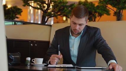 Young businessman checks finances