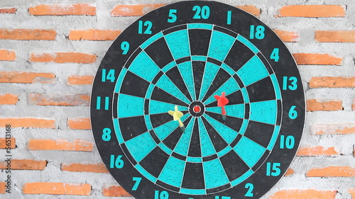 Dartboard with Darts Hitting on Target Bullseye