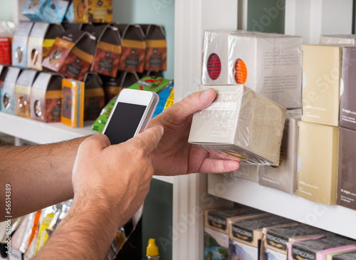 Man's Hand Scanning Product Through Mobile Phone Poster