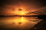 Curvy bridge in silhouette at sunrise in Putrajaya, Malaysia