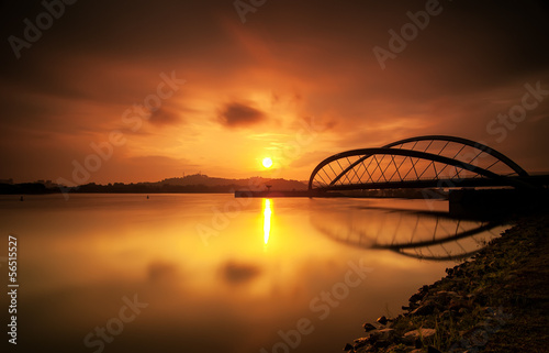 Curvy bridge in silhouette at sunrise in Putrajaya, Malaysia