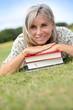 Portrait of senior woman reading book