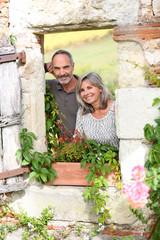Cheerful senior couple enjoying country home
