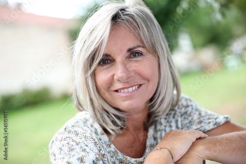 Portrait of serene mature woman in garden