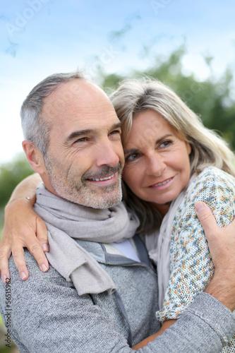 Cheerful senior couple enjoying peaceful nature