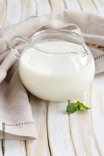 glass jug with milk, rustic style