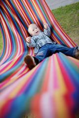 Lovely girl resting in a hammock