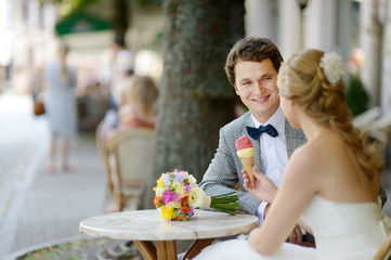 Bride and groom having an ice cream outdoors