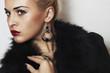 beautiful blond woman.Jewelry and Beauty. Fur.red lips