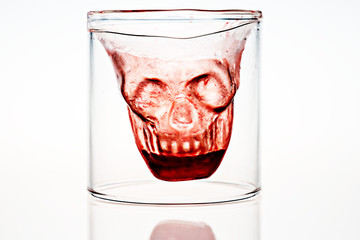Halloween skull faced alcohol shot glass with fake blood inside