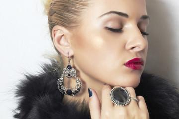 beautiful blond woman.Jewelry and Beauty.red lips