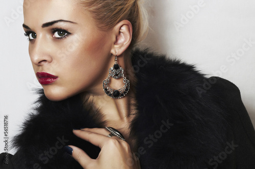 beautiful blond woman.Jewelry and Beauty.in fur coat